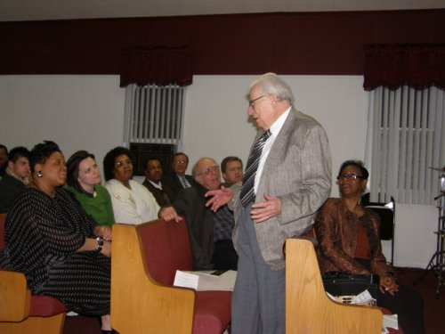 Dr. Stanley Horton extemporaneously addressing participants at A House No Longer Divided, Timmons Temple COGIC, Monday, April 13. Horton was explaining that his father was pastor of a multiracial church in Arroyo Seco, Los Angeles, in 1926-1927. Members – half were black, half were white – would eat dinner together after every Sunday service. (Photo courtesy of Ken Horn)