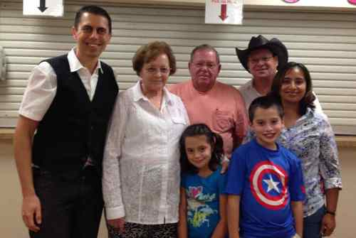 Flower Pentecostal Heritage Center Director Darrin Rodgers (left) meets Jim Etterman (back row, center), Pete Etterman (back row, right) and their families.