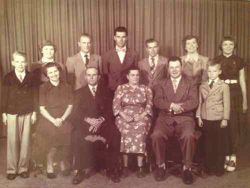 A. G. and Annie Etterman and ten children. Taken  1950s.