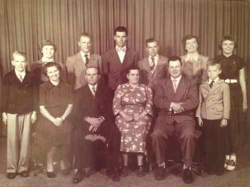 A. G. and Annie Etterman and ten children. Taken  1950s.