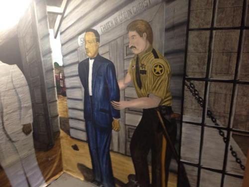 Bishop Mason was incarcerated in 1918 in the jail cell in the Holmes County Courthouse. He was falsely accused of treason by those opposed to his Holiness message. The jail cell is now a pilgrimage site, open to the public and decorated with hand-painted murals depicting his incarceration.
